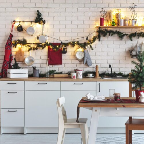 interior-white-kitchen-with-lights-and-red-christmas